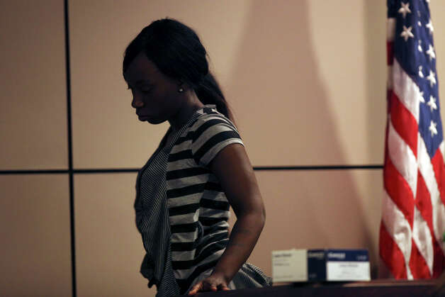 Shayla James leaves the witness stand after testifying for the defense during the murder trial of her sister, Tiffany James, 20, in the Bexar County 399th District Court, Monday, July 23, 2012. James is accused of stabbing and killing her boyfriend, Antwan Wolford, in November 2009. If convicted, James faces life in prison. He was also the father of her child. Photo: Jerry Lara, San Antonio Express-News / © 2012 San Antonio Express-News