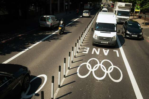 Traffic passes through special Olympic lanes in central London on Monday, July 23, 2012, in London. Only accredited vehicles will be able to use the special Olympic lanes, sparking uneasiness among some in the city and protests by London's taxi drivers, who have been excluded from using them. The use of the lanes goes into effect a few days before Opening Ceremonies for the 2012 Summer Olympics on Wednesday, July 25. Photo: Smiley N. Pool, Houston Chronicle / © 2012  Houston Chronicle