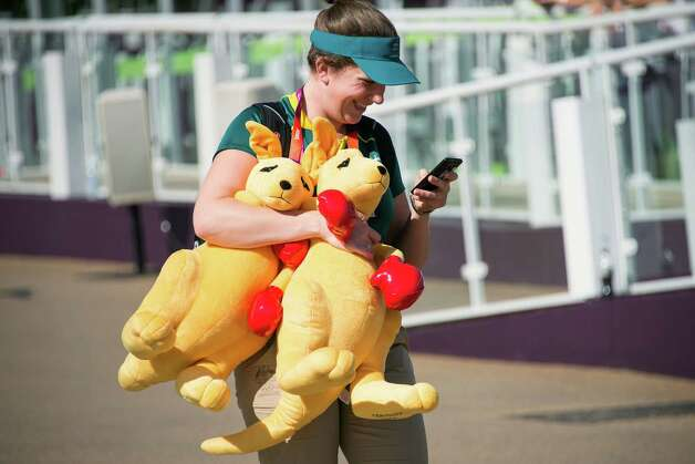 A member of the Australian team carries two of the Aussie boxing kangaroo mascot while walking through the common area of the athletes village for the 2012 London Olympics on Monday, July 23, 2012, in London. Photo: Smiley N. Pool, Houston Chronicle / © 2012  Houston Chronicle