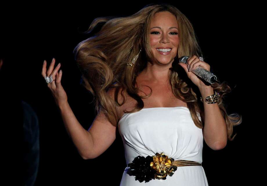 Mariah Carey likes wine and white roses. Not too bad for a diva... Photo: Lionel Cironneau / AP