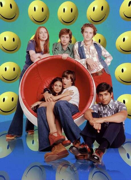 "Ashton Kutcher and Mila Kunis were chummy as far back as 1998, on ""That '70s Show."" Photo: Michael Lavine / Fox Broadcasting Company"