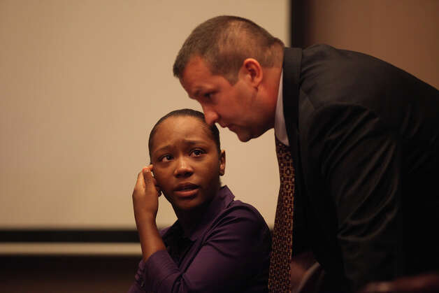 Defendant Tiffany James confers with defense attorney Robert Gebbia on the first day of her trial for the murder of Antwan Wolford in the 399th District Court in San Antonio on Thursday, July 19, 2012. Photo: Lisa Krantz, San Antonio Express-News / San Antonio Express-News