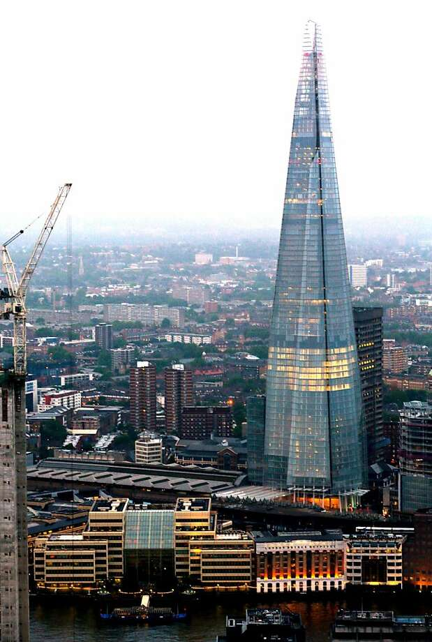 The Shard tower is seen illuminated by lights on the city skyline in London, U.K. on Thursday, July 12, 2012. The 310-meter (1,017 feet) Shard will have a Shangri-La hotel, about 585,000 square feet (53,350 square meters) of office space for which no tenant has been found, 10 luxury apartments and some shops. Photographer: Jason Alden/Bloomberg Photo: Jason Alden, Bloomberg