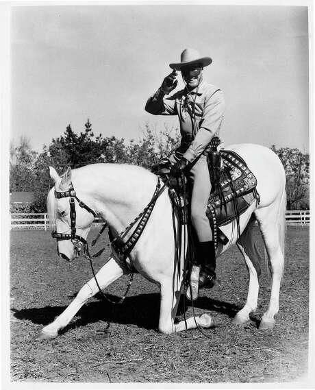 """Silver, carrying the Lone Ranger, takes a bow in this 1955 photo. DreamWorks Animation SKG is buying Classic Media, whose roster includes """"The Lone Ranger,"""" """"Frosty the Snowman"""" and """"Lassie."""" Classic Media owns 450 movies and 6,100 episodes of TV shows, / Handout"""