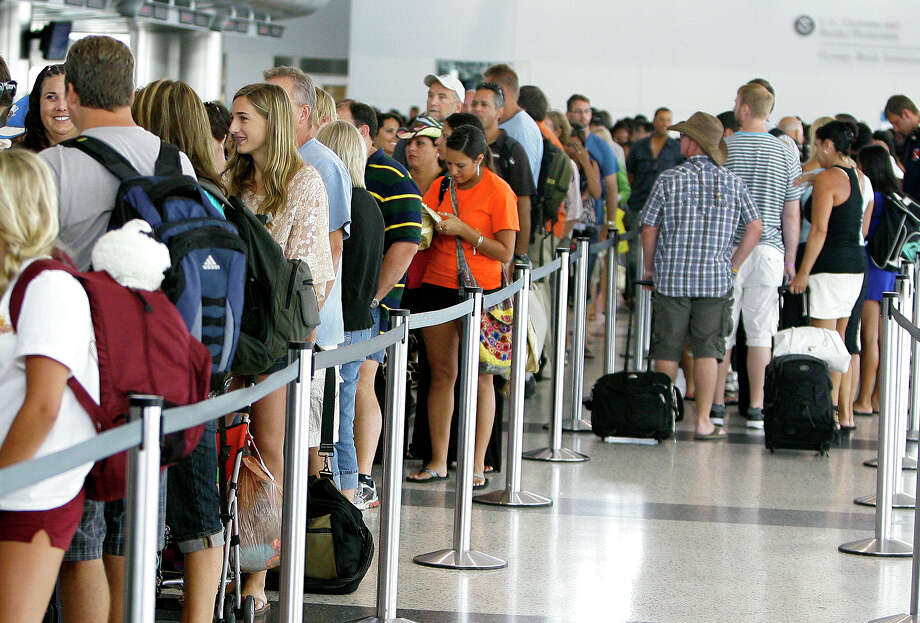 Passengers wait to go through security at Bush Intercontinental Airport in 2012. Photo: Cody Duty / © 2011 Houston Chronicle