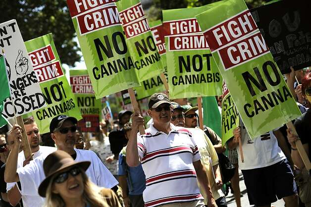 Supporters of medical marijuana march down Broadway in protest of President Obama's  Crackdown in Oakland. Photo: Michael Short, Special To The Chronicle