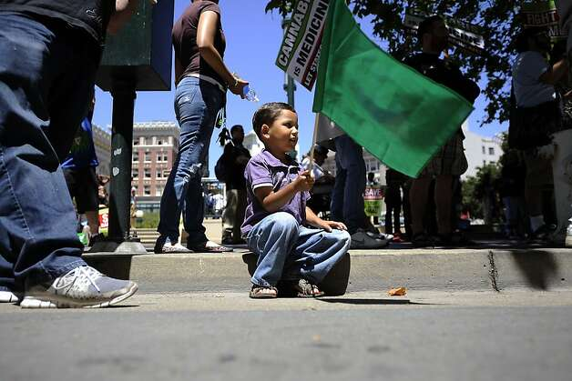 Jeffery Geroge Chico (4 1/2 years old), of Castro Valley, waves a green flag in support of medical marijuana.  President Obama gave a speech at the Fox Theater during a fundraising stop in downtown Oakland, CA Monday July 23rd, 2012 Photo: Michael Short, Special To The Chronicle