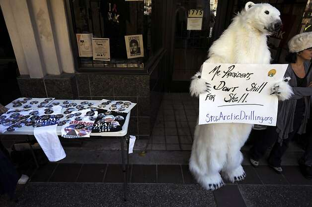 A demonstrator in a polar bear suit is among a group protesting against expansion of drilling for oil in the Arctic. Photo: Michael Short, Special To The Chronicle