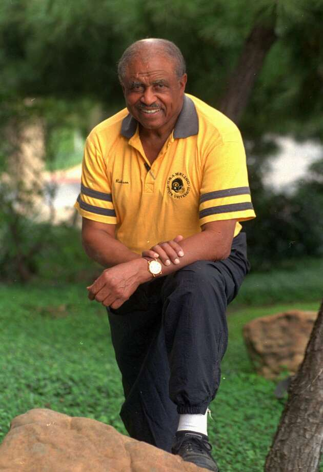 FILE--Grambling State coach Eddie Robinson is shown in Dallas in this Sept. 30, 1994 photo.  Only in America, Eddie Robinson said Friday, Aug. 28, 1998, could a kid from Baton Rouge, La., grow up to coach a college football team and end up with a charity game named after him. The former Grambling coach, who retired last year said he's awed by the Eddie Robinson Football Classic, which pits Nebraska against Louisiana Tech on Saturday.  Money from the game will go to Robinson's foundation, which provides scholarships to underprivileged college students. (AP Photo/Eric Gay, file) Photo: ERIC GAY / AP