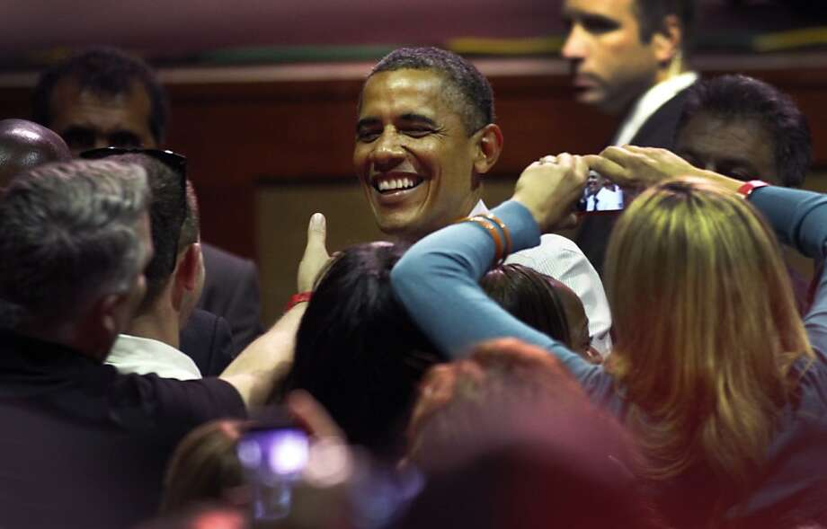 President Obama greets supporters at Oakland's Fox Theater, where he blasted the ideas of Republican rival Mitt Romney. Photo: Sarah Rice, Special To The Chronicle