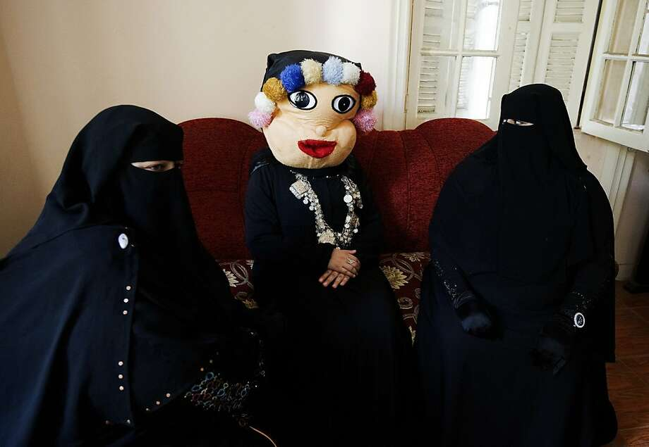 An Egyptian woman wearing a mask and two niqab-clad women attend an editorial meeting on a children's TV show at Egypt's new Maria TV studios in Cairo on July 23, 2012. Maria TV, named after one of Prophet Mohammed's wives, is run by Egyptian women and will only feature women wearing the full Islamic veil. Photo: Gianluigi Guercia, AFP/Getty Images