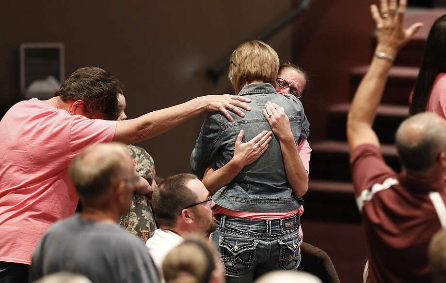Krista Stibal, right, and her mom Margaret Shepard, left, embrace Heather Collins, center, mother of missing Elizabeth Collins and Lyric Cook-Morrissey, during a prayer vigil held for the two cousins at Heartland Vineyard Church Monday, July 23, 2012, in Cedar Falls, Iowa. The girls went missing Friday afternoon July 13. Photo: Matthew Putney, Associated Press