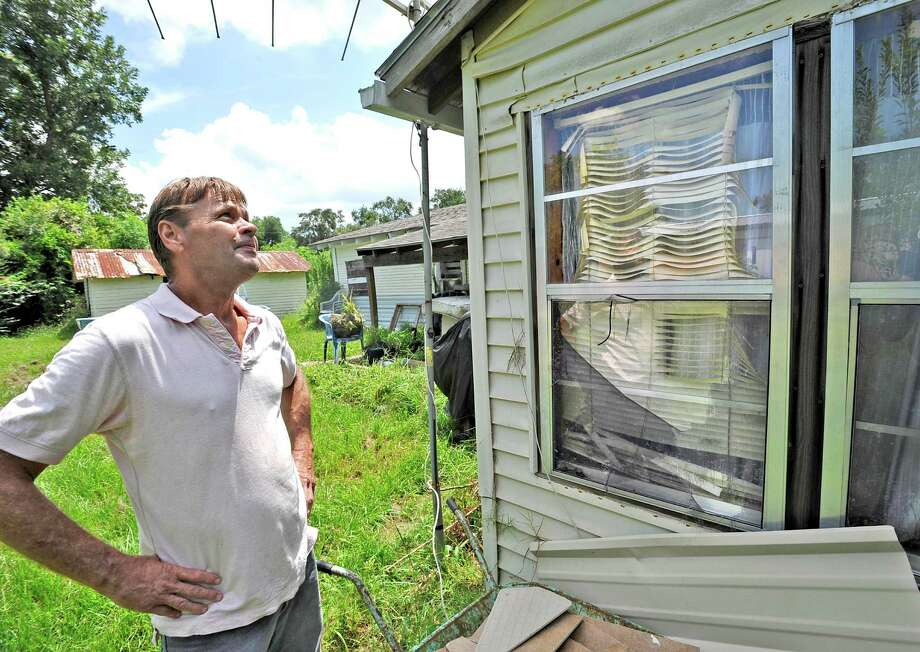 Lightning hit an ethylene control valve on a Chevron pipeline on West Port Arthur Road near 61st Street just before 5 p.m. Saturday night.  On Monday afternoon, John Miller was walking around his mother's home at 2104 60th Street. It was partially protected from the fire by a neighbors home, but still had damage like these windows where the glass was intact, but the blinds had melted.  Chevron officials were on site evaluating the damage and beginning repairs.  Dave Ryan/The Enterprise Photo: Dave Ryan