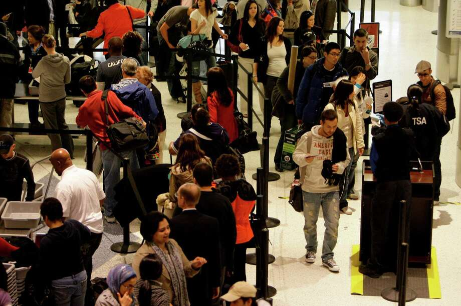 Passengers wait in security line at George Bush Intercontinental Airport  Terminal C Monday, Dec. 28, 2009, in Houston.  ( Melissa Phillip / Chronicle ) Photo: Melissa Phillip, Staff / Houston Chronicle