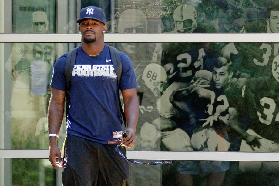 Penn State University football  running back Silas Redd leaves the Lasch Football building after a team meetings explaining the ramifications of the NCAA sanctions against the Penn State University football program in State College, Pa.,  Monday, July 23, 2012.  (AP Photo/Gene J. Puskar) Photo: Gene J. Puskar, Associated Press / AP