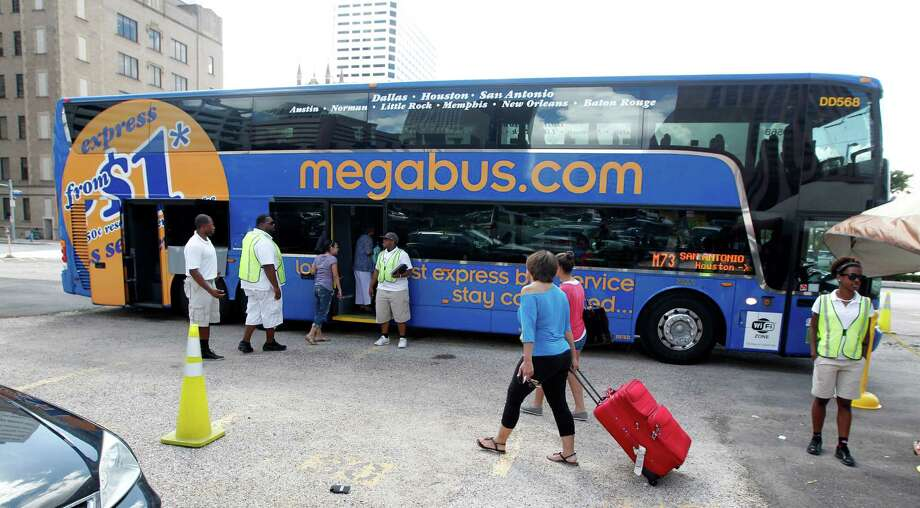 Passengers board a Megabus at Travis and Clay streets, Megabus is a low-cost inter-city bus company that has recently started service in Texas Tuesday, July 17, 2012, in Houston. ( James Nielsen / Chronicle ) Photo: James Nielsen / © Houston Chronicle 2012