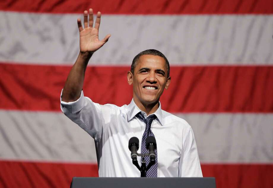 President Barack Obama, waving during a campaign stop Monday in California, is scheduled to visit Westport next month for a $38,500-a-head fundraiser. Photo: Paul Sakuma, File Photo / AP