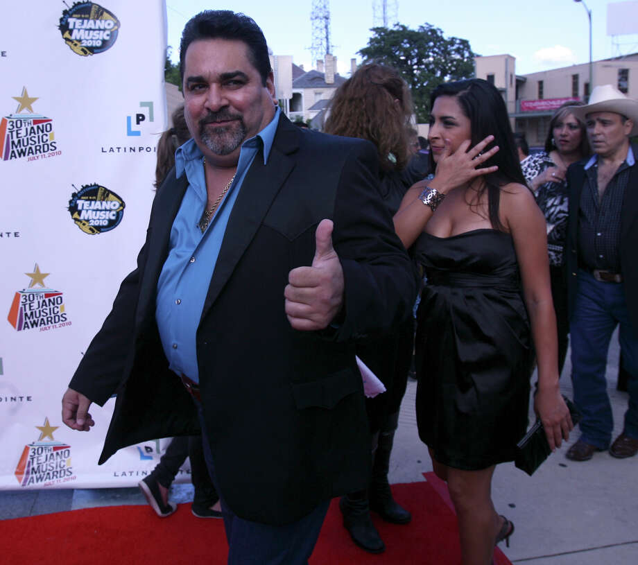Ram Herrera gives the thumbs up while walking the red carpet before the Tejano Music Awards Sunday. Photo: JOHN DAVENPORT, SAN ANTONIO EXPRESS-NEWS / jdavenport@express-news.net