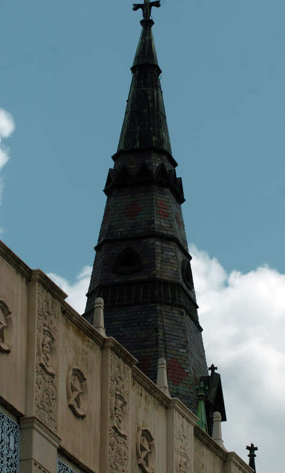 The steeple of St. Joseph's church rises above Rivercenter mall on Commerce Street. / SAN ANTONIO EXPRESS-NEWS