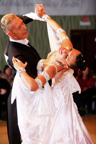 Morten Schnedler and Anna Trukhan, the professional ballroom dance champions of Denmark, will perform at Holy Trinity Greek Church Community Center, 4070 Park Ave., Bridgeport, Conn.,  on Saturday, July 28, 2012, during a salute to Fred Astaire. The $17 admission fee includes dancing, a dance lesson and the show. To reserve a spot, call 203-374-7308. Photo: Contributed Photo