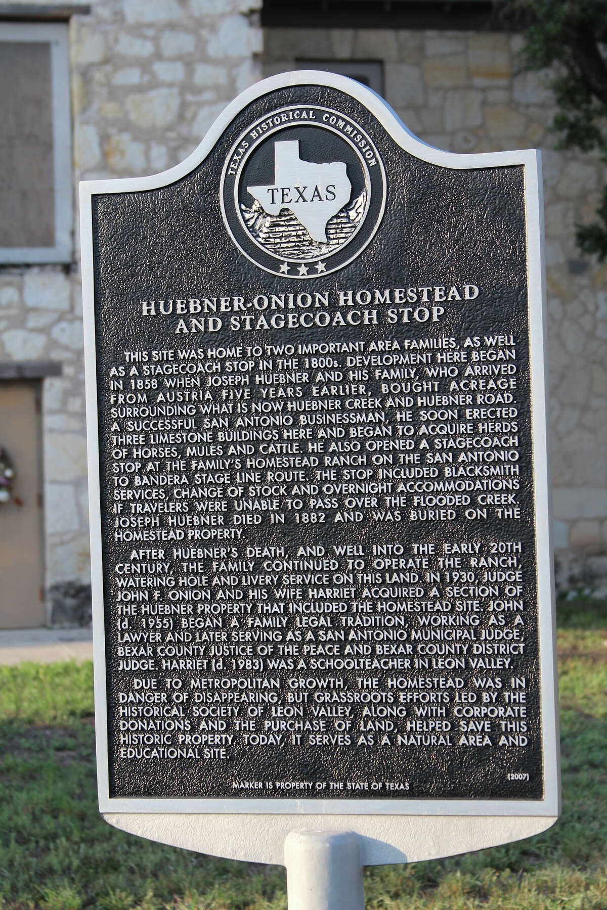 A Texas Historical Commission sign spells out the significance of the Huebner-Onion Homestead and Stagecoach Stop, a site 10,000 or more motorists pass by every day on Bandera Road in Leon Valley.