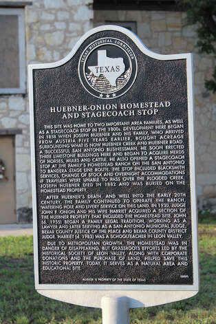 A Texas Historical Commission sign spells out the significance of the Huebner-Onion Homestead and Stagecoach Stop, a site 10,000 or more motorists pass by every day on Bandera Road in Leon Valley. Photo: Lauri Gray Eaton / Northwest Weekly
