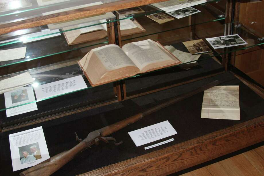 A Winchester rifle and historical documents are now on view at Helotes City Hall, where the Historical Society of Helotes plans a revolving menu of displays. Photo: Lauri Gray Eaton / Northwest Weekly