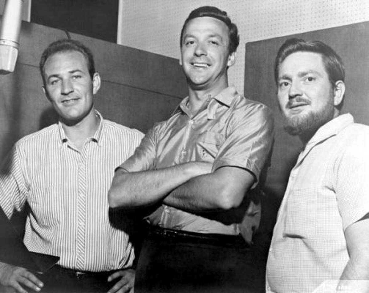 Fred Foster, then president of Monument Records, poses with his newest signees, Fred Carter (left) and Willie Nelson, circa 1960.