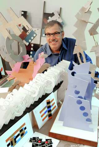-Robert Gregson with his artwork in his Orange home. Photo: Contributed Photo