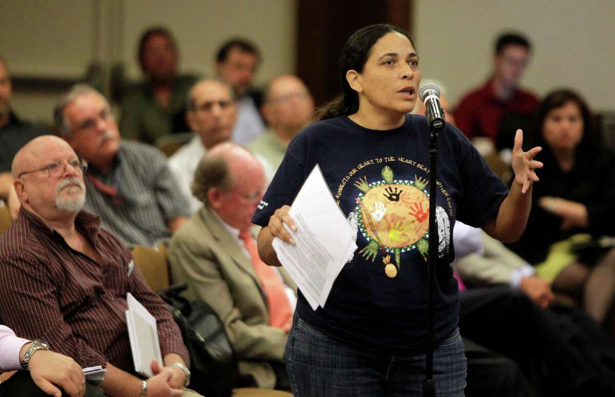 Cherri Foytlin of Rayne, LA asks a question during the Chemical Safety Board public hearing at the Hyatt Regency Hotel, 1200 Louisiana Street, Tuesday, July 24, 2012, in Houston. She said her husband is an oil worker.