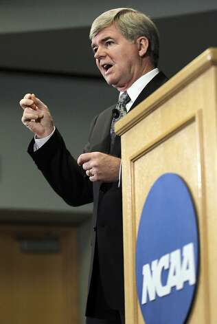 NCAA President Mark Emmert gestures during a news conference in Indianapolis, Monday, July 23, 2012. The NCAA has slammed Penn State with an unprecedented series of penalties, including a $60 million fine and the loss of all coach Joe Paterno's victories from 1998-2011, in the wake of the Jerry Sandusky child sex abuse scandal.  (AP Photo/Michael Conroy Photo: Michael Conroy, Associated Press
