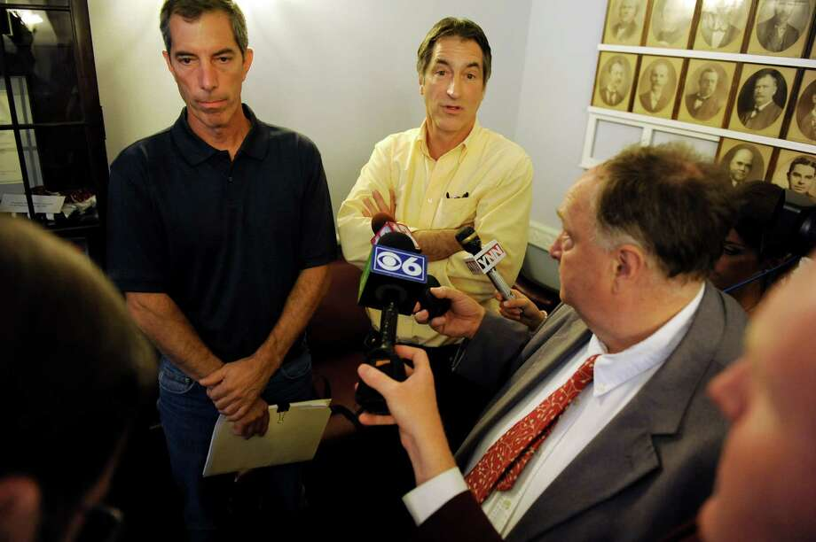 Jeff LeGere, left, and Ray Legere, owners of Legere Restorations, talk with the media on Tuesday, July 24, 2012, at Schenectady City Hall in Schenectady, N.Y. The cousins purchased the Schenectady armory for $260,000 during an auction of the property. (Cindy Schultz / Times Union) Photo: Cindy Schultz / 00018569A