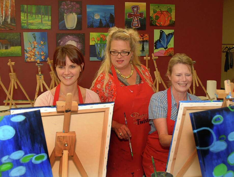 Instructor Jaki Wilkinson, of Houston 77090, helps Debbie Hollander, of Conroe, and Sheila Blue, of Spring 77379, with their paintings at Painting With a Twist, 570 Sawdust. Palmer's friends threw her a surprise birthday at Painting with a Twist, which  allows guests to experience working with an artist onsite and to create their own masterpiece.  Photo by David Hopper Photo: David Hopper / freelance