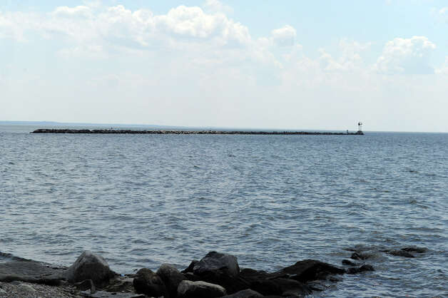The seawall at the exit of Stamford Harbor in Stamford, Conn. on Tuesday July 24, 2012. Keith Morris of New Rochelle, N.Y. was killed when his boat hit the seawall and capsized on Sunday July 22, 2012. Photo: Keelin Daly / Stamford Advocate