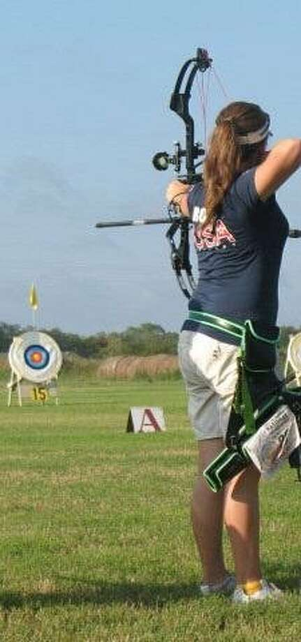 In six years of competitive archery, former Spring resident Kayleigh Rogers, 18, has made tremendous strides and will compete in an international world championship in France next month. Photo: COURTESY KAYLEIGH ROGERS