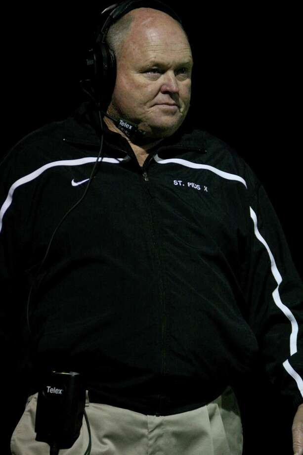 St. Pius X head coach Robin Kirk watches during a game against St. Thomas. Photo: Jason Brown / Freelance