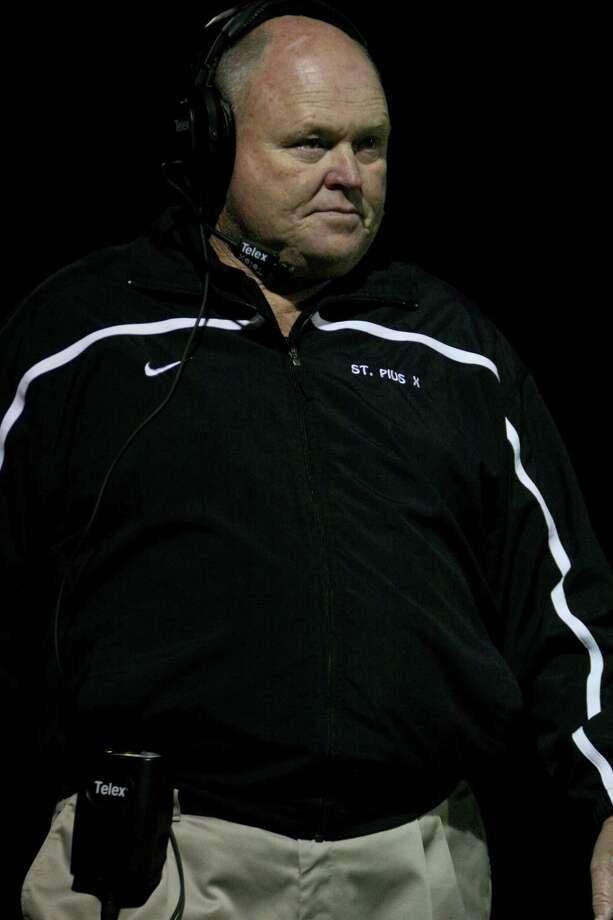 St. Pius X head coach Robin Kirk watches during a game against St. Thomas. Photo: Jason Brown / Freelance