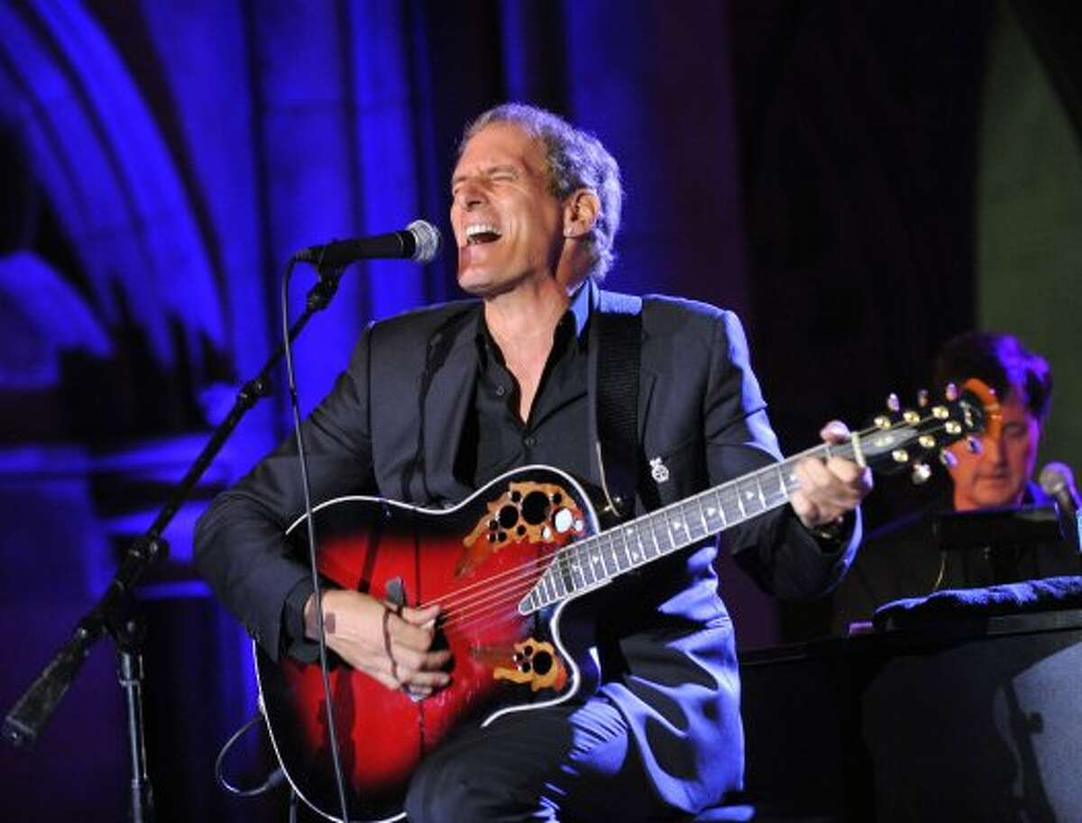 LONDON - AUGUST 5: Michael Bolton performs live at the FitFlop Shooting Stars Benefit Closing Ball following a two-day golf tournament raising vital funds for Make-A-Wish Foundation UK at the Royal Courts of Justice on August 5, 2011 in London, England. (Photo by Samir Hussein/Getty Images for FitFlop Shooting Stars Benefit)