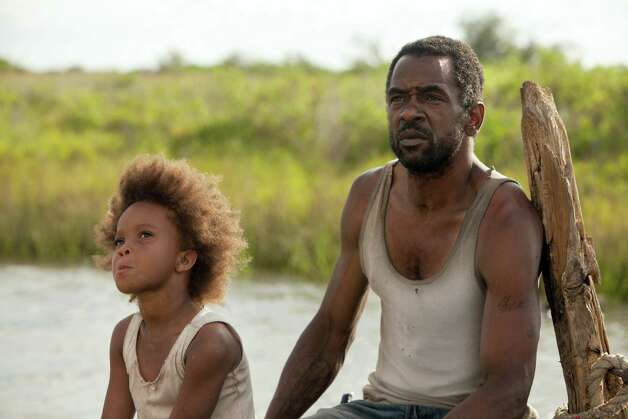 "This film image released by Fox Searchlight Pictures shows Quvenzhane Wallis portraying Hushpuppy, left, and Dwight Henry as Wink in a scene from, ""Beasts of the Southern Wild."" Photo: AP"