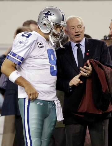 FILE - In this Dec. 11, 2011, file photo, Dallas Cowboys quarterback Tony Romo (9) and team owner Jerry Jones, right, talk before an NFL football game against the New York Giants, in Arlington, Texas. Immediately after Dallas' last game against the Tampa Bay Buccaneers, owner Jerry Jones said it'd be ashamed for the Cowboys not to make the playoffs the way Tony Romo is playing. The quarterback still won't have a winning December, but he has thrown eight touchdowns with no interceptions this month for the NFC-East leading Cowboys. Photo: AP