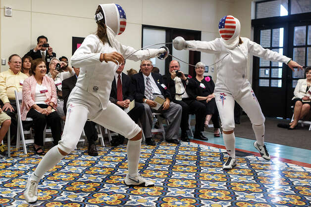 Kelly (left) and Courtney Hurley give an épée demonstration on July 11. Courtney, 21, is making her Olympic debut this morning with high hopes. Photo: MARVIN PFEIFFER, Marvin Pfeiffer / Prime Time Newspapers / Prime Time Newspapers 2012
