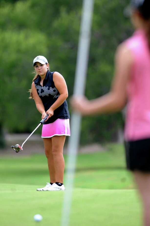Sierra Sanchez intently watches her putt during first-round action Tuesday at the Greater San Antonio Junior Championship at Brackenridge Park Golf Course. Photo: Billy Calzada, San Antonio Express-News / © 2012 San Antonio Express-News