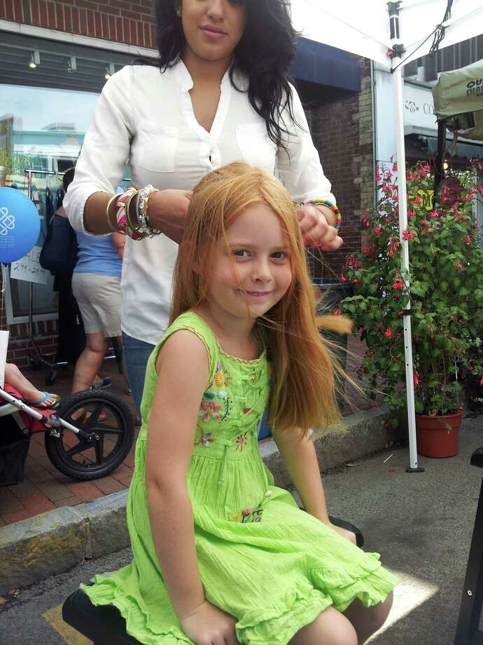 Dozens of girls sought to have their hair braided by the stylists at Salon KiKloís charity event during the recent sidewalk sales. All proceeds were donated to the New Canaan Outback Teen Center. Photo: Contributed Photo