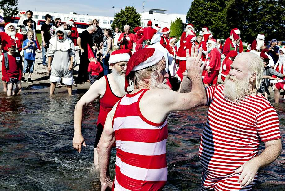 Bellevue Beach in Klampenborg, Denmark Bonus: Santas from all parts of the world take part in the traditional foot bath in July at this beach. Photo: Casper Christoffersen, AFP/Getty Images