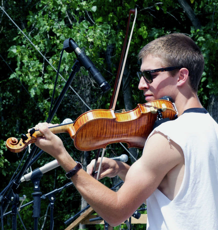 Max Rainwater of Columbia works his magic on an old-time fiddle to earn third-place recognition during the Roxbury Volunteer Fire Department's annual Pickin' and Fiddlin' Contest at Hurlburt Community Park in Roxbury. Photo: Trish Haldin