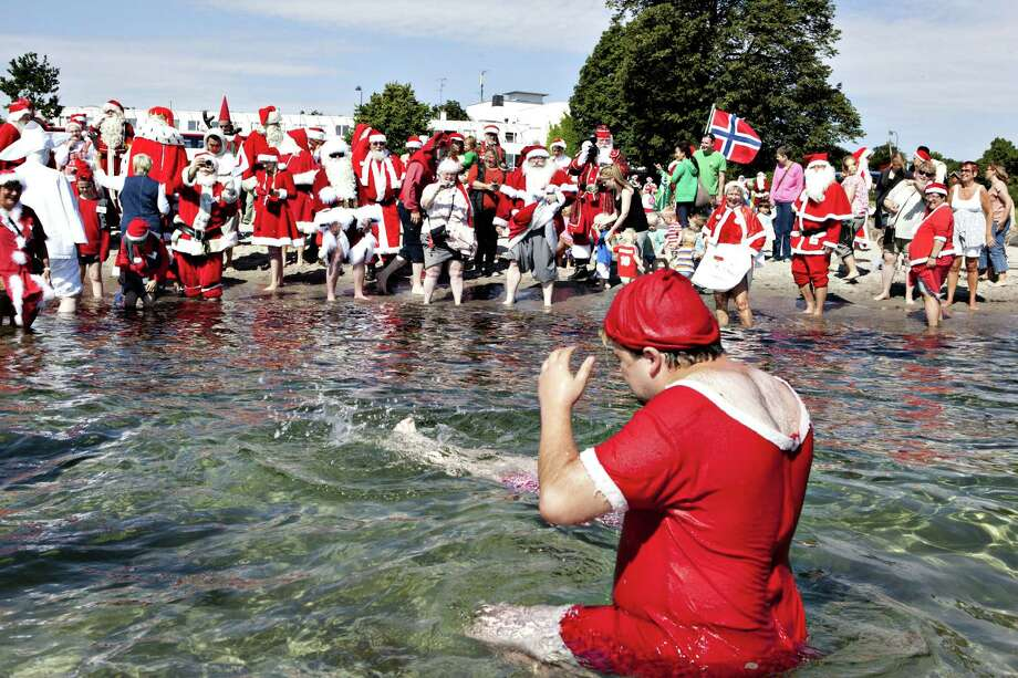 Bellevue Beach in Klampenborg, DenmarkBonus: Santas from all parts of the world take part in the traditional foot bath in July at this beach. Photo: CASPER CHRISTOFFERSEN, AFP/Getty Images / AFP