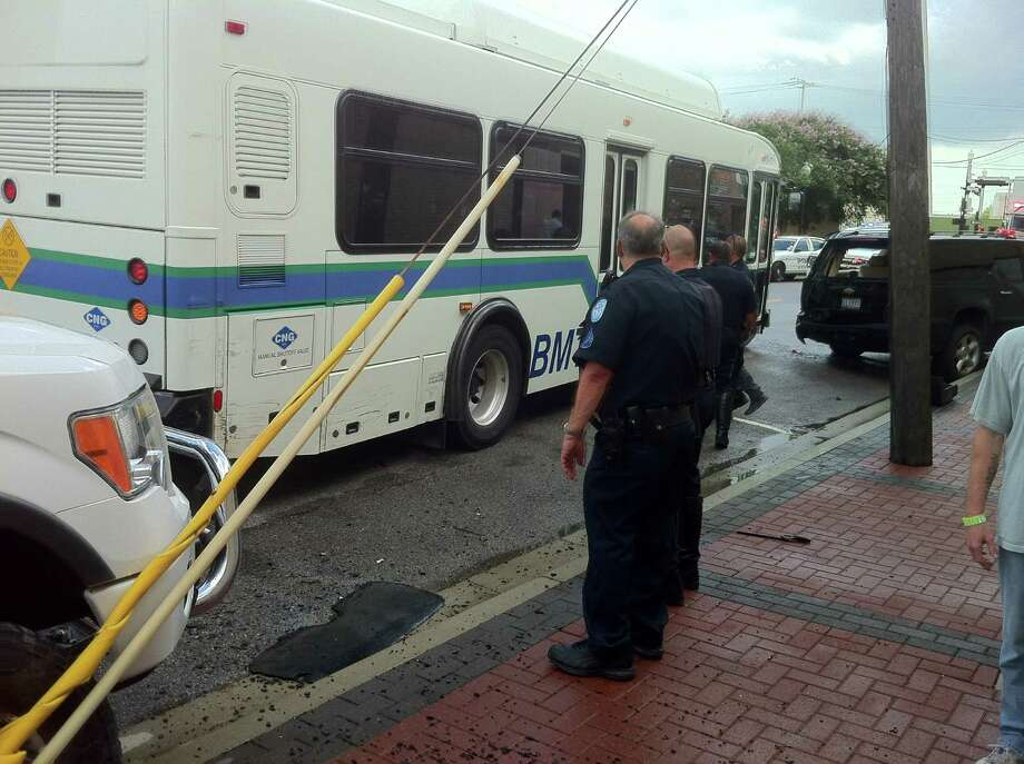 A city bus sits damaged after police say the driver rounded the corner of Park Street and Wall Street too fast, striking a pedestrian. Photo: Clay Thorp
