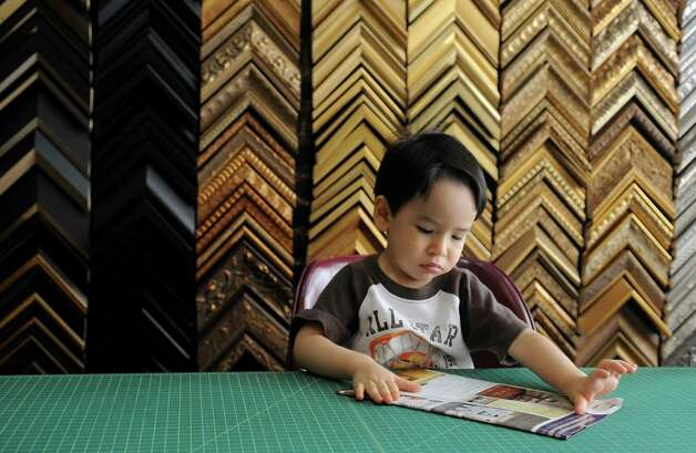 Diego Bars, 2, appears to be hard at work at his parents' business, U & I Deco in Stamford on Tuesday, July 24, 2012. Photo: Lindsay Niegelberg / Stamford Advocate