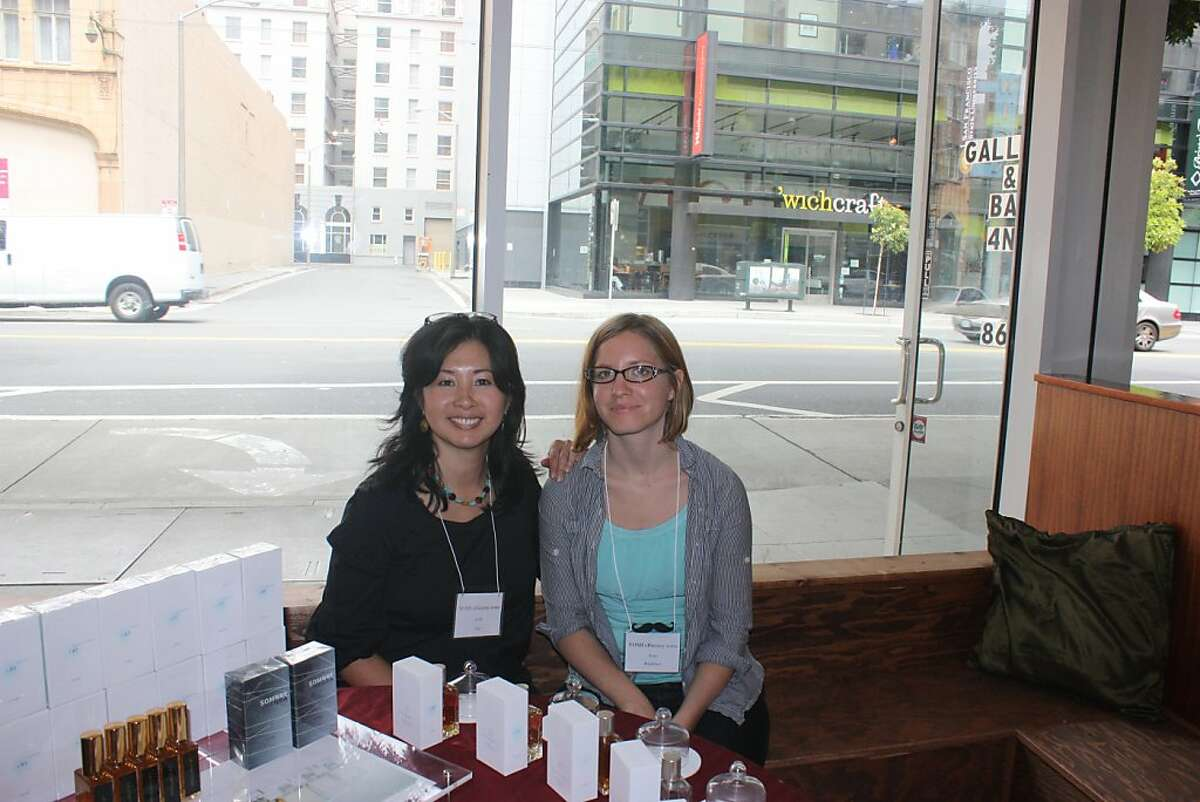 Perfumer Yosh Han with a friend at the Artisan Fragrance Salon July 8 in San Francisco.