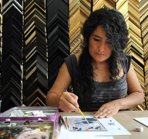 Ana Maria Bars paints freehand on a frame mat at U & I Deco in Stamford on Tuesday, July 24, 2012. Photo: Lindsay Niegelberg / Stamford Advocate